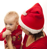 Cute baby with her mother. Christmas time - little baby with her mother in christmas  cloth Stock Photo