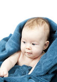 Cute baby hiding in blue blanket Royalty Free Stock Images