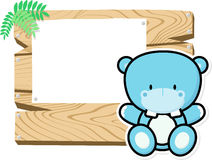 Cute baby hippo on wooden board Stock Image