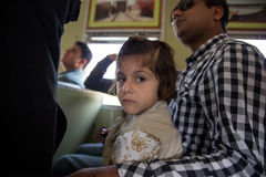 A cute baby with his father in train enjoy Azadi Train Stock Photo
