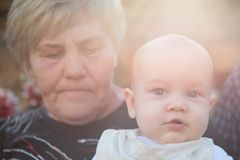 Cute baby with his granny Royalty Free Stock Photo