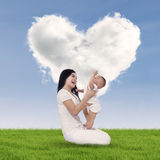Cute baby and his mother outdoors Stock Photography