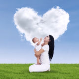 Cute baby and his mother outdoors Royalty Free Stock Photo