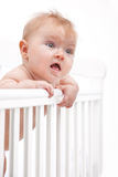 Cute baby holding bed rail Royalty Free Stock Images