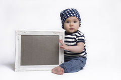 Cute baby holding a blank framed sign Royalty Free Stock Photos