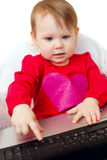Cute baby  holding laptop Royalty Free Stock Photo