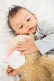 Cute baby holding plush Stock Photography