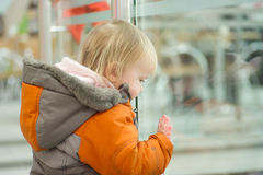 Cute baby holds glass border look down Stock Photo