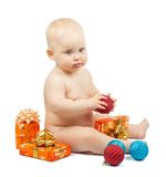 Cute baby holds red ball, christmas gift box Royalty Free Stock Photos
