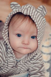 Cute baby in hood with ears Stock Images