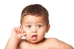 Cute baby infant with big green eyes thumb on cheek on white royalty free stock image