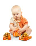 Cute baby keeps colorful gift box Royalty Free Stock Photos