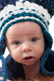Cute baby in knitted hat Stock Photos