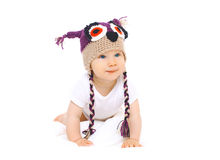 Cute baby in knitted hat crawls on white background Royalty Free Stock Image
