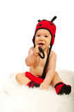Cute baby in ladybug hat Royalty Free Stock Photography