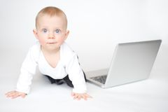 Cute baby with laptop Stock Photos