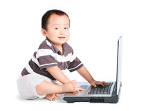 Cute baby and laptop computer Stock Photos