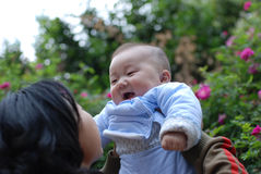Cute baby laugh with  mother. Cute baby boy laugh with his mother Stock Photography