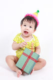 Cute baby laughing wearing party hat Royalty Free Stock Images