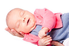 Cute baby laying in hand Royalty Free Stock Images
