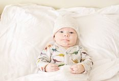Cute baby in bed stock images
