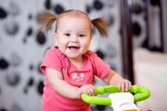 Cute baby learning to walk Royalty Free Stock Image