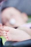 Cute baby legs in the carriage Stock Photos
