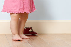 Cute baby legs in room royalty free stock images