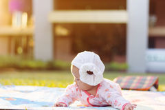 Cute  baby lie prone on ground at park. Cute Asian baby lie prone on ground at park Stock Image