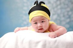 Cute baby lie and watch Stock Photography
