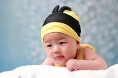 Cute baby lie and watch Stock Images