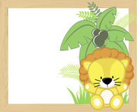Cute baby lion frame. Cute baby lion with tropical leaves and palm tree on empty wood frame for copy space, ideal for nursery art decoration or scrapbooking Royalty Free Stock Image