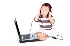 Cute baby listening to music Stock Image