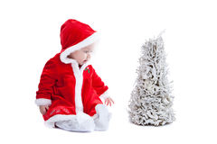 Cute baby in little santa suit Stock Image