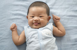 Cute baby. Looking at the camera Stock Photography