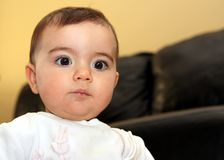 Cute baby looking down. With her big brown eyes royalty free stock photos