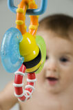 Cute Baby Looking at Toy Royalty Free Stock Photography