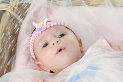 Cute baby lying in the basket Royalty Free Stock Photos