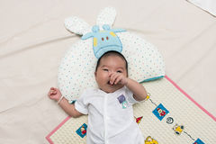 Cute baby lying on the bed. Cute baby newborn lying on the bed Stock Photo