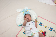 Cute baby lying on the bed. Cute baby newborn lying on the bed Stock Photography