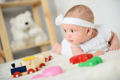 Cute baby lying on bed Stock Photos