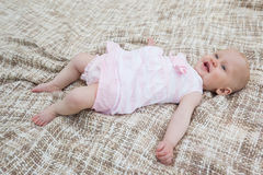 Cute baby lying on blanket Stock Images