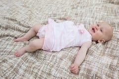 Cute baby lying on blanket. Full length high angle view of a cute baby lying on blanket Stock Images