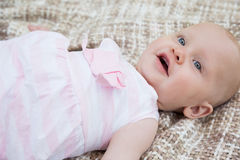 Cute baby lying on blanket. High angle view of a cute baby lying on blanket Royalty Free Stock Photos