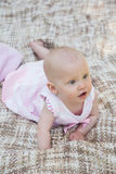 Cute baby lying on blanket. High angle view of a cute baby lying on blanket Royalty Free Stock Image