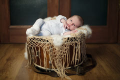 Cute baby lying on the drum Stock Photography