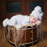 Cute baby lying on the drum Royalty Free Stock Photos