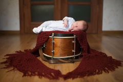 Cute baby lying on the drum Royalty Free Stock Image