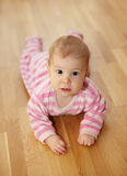 Cute baby lying on floor Stock Photo