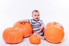 Cute baby lying on his stomach on a white background including p stock images